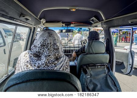 MARGILAN UZBEKISTAN - AUGUST 20: First person view from the inside of Uzbek minibus called marshrutka. August 2016