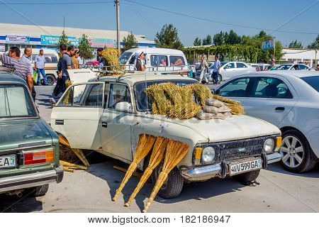 MARGILAN UZBEKISTAN - AUGUST 21: Old Lada car with brooms for sale at Kumtepa bazaar. Market in one the the biggest in the area running once a week. August 2016