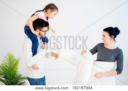 A happy family having fun pillow fighting