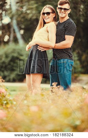 Couple Hugging In Park.