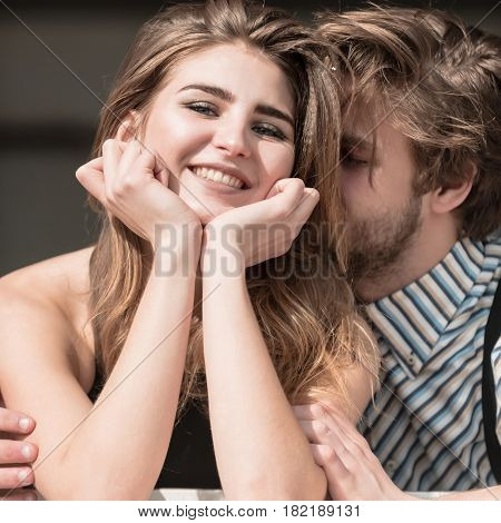 Love and happiness. Happy young couple on sunny summer day outdoors. Pretty girl or beautiful woman with long blond hair and handsome man with beard smiling. Spending time together and having fun