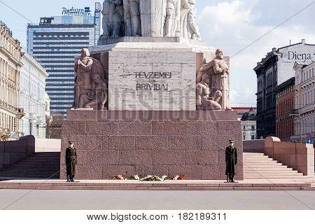Riga, Latvia - April 16, 2018: Statue of Liberty on Freedom Monument in Riga city, Latvia.