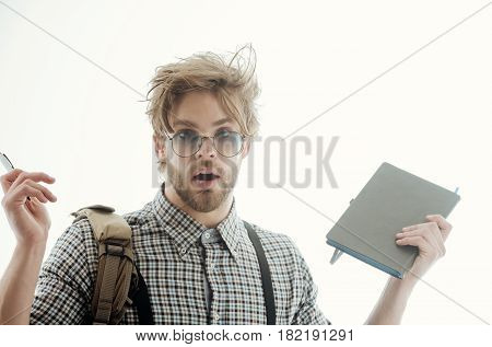 Surprised Handsome Man In Nerd Glasses Holding Pen And Notebook