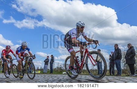 Hornaing France - April 102016: The Spanish cyclist Markel Irizar Aranburu of Trek-Segafredo Team riding in the peloton on a paved road in Hornaing France during Paris Roubaix on 10 April 2016.