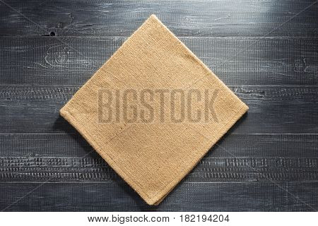 burlap hessian napkin on wooden background