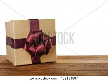 Beautiful gift box with vinous ribbon and blank label on wooden table