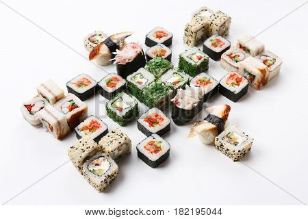 Japanese food restaurant delivery - sushi maki, unagi and california roll big party platter set isolated on white background