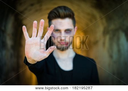 Man showing hand with text