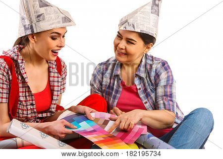 Repair home women holding color guide for wallpaper. Elderly mother and daughter renovation apartment on isolated.