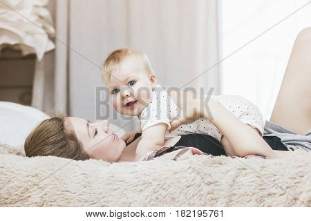 Mother And Little Baby In Bed And Woke Up In The Morning And Smiling