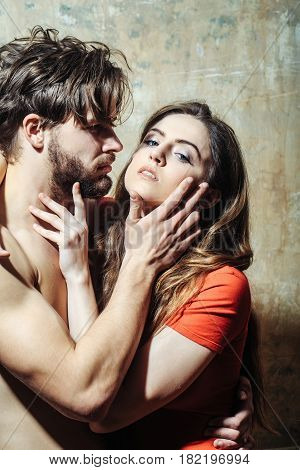 Young Couple Of Pretty Girl And Bearded Man Hugging