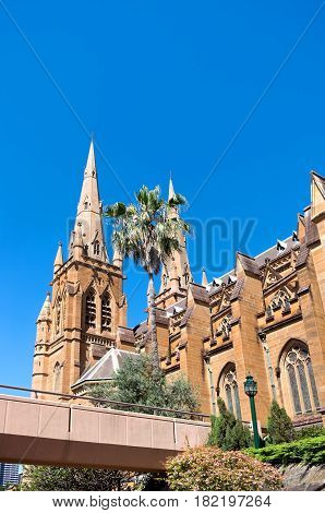 landmark cathedral of victorian gothic architectural style and walkway to rear entrance in sydney new south wales australia