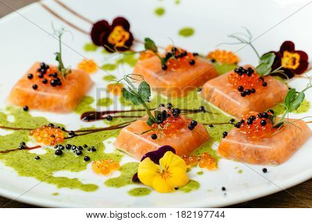 Aspic from salmon in on a large white plate