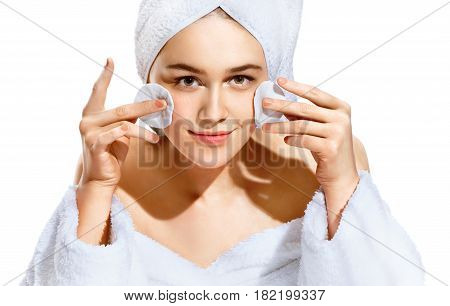 Woman using cotton pad. Portrait of smiling beautiful woman cleaning skin by cotton pad. Skincare concept