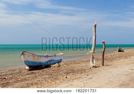 Colombia wild coastal desert of Penisula la Guajira near the Cabo de la Vela resort. The picture present traditional fishing boat.