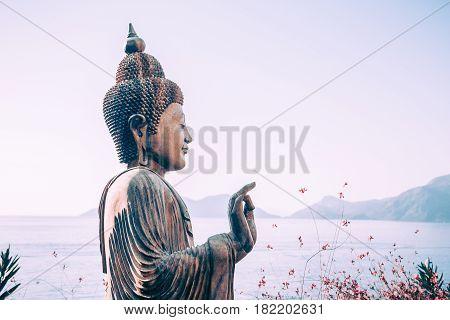 Buddha statue outdoors near the sea close-up