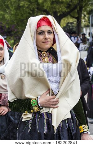 MURAVERA, ITALY - April 2, 2017: 45th Festival of citrus - portrait of a beautiful woman of the Cultural Association of Saint Andrew Gonnesa - Sardinia