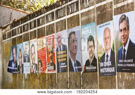 Benon, France- April 18, 2017 : Campaign Posters For The 2017 French Presidential Election In A Smal