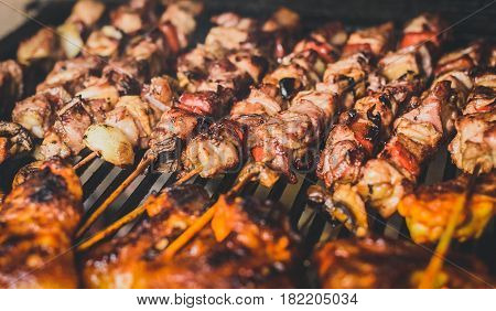 Grilling Meat Skewers And Chicken On Natural Charcoal Barbecue Grill.
