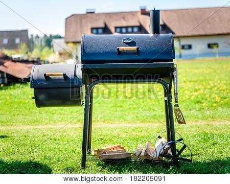 Preparing Delicious Meat In Slow Cooking Smoker In Backyard.