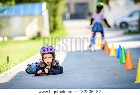 Child Fell While Learning To Roller Skate On The Road.