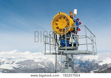 Snow machine in front of blue sky