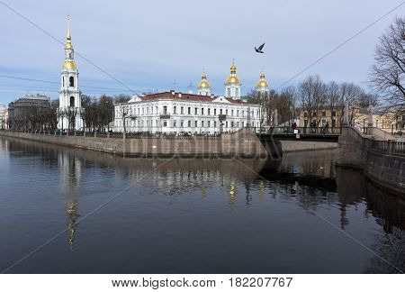 St. Nicholas naval Cathedral channel water a dove flying building Golden domes the city view of St. Petersburg bridge blue sky reflection reflected