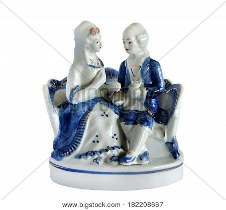 Vintage style serial porcelain figurine Couple in love isolated on white background