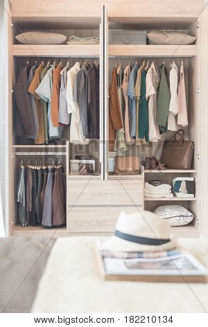 clothes hanging on rail in modern bedroom