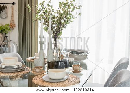 Glass Dining Table With Table Set In Modern Dining Room