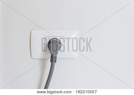 Socket Plug With Electric Plug Line On White Wall