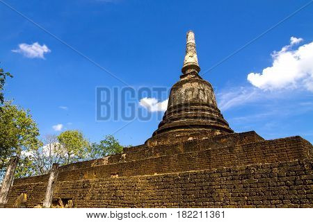Wat Khao Suwankhiri temple and bright sky in Sisatchanalai Historical Park Sukhothai province Thailand poster