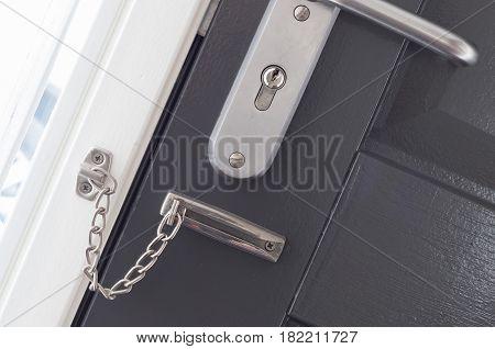 Door Chain On A Grey Door
