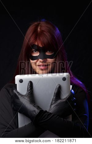 Brunette hacker cuddle stolen laptop