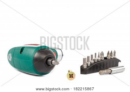 Electric screwdriver with interchangeable bits isolated on white background.