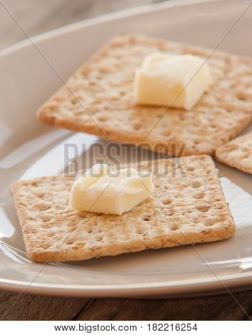 Cracker close up on white plate on the table