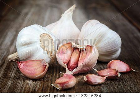 Fresh fruit garlic on a wooden background.
