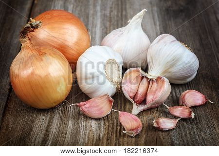 Fresh garlic on the a wooden background.