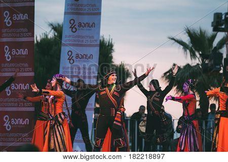 Batumi, Adjara, Georgia - May 26, 2016: People dressed in traditional folk costume dancing during the celebration of Georgia's Independence Day