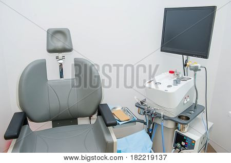 Interior Of Modern Ent Clonic. Professional Evo Ent Medical Devices Workstation And Chair In Office.