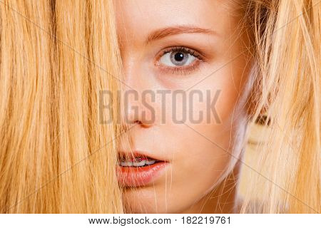 Blonde Woman Holding Her Long Tangled Hair