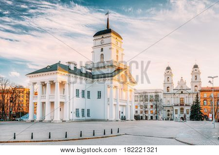 Minsk, Belarus. Famous Landmark - Old Minsk City Hall on Freedom Square Hall In Sunny Spring Evening Day. Town Hall