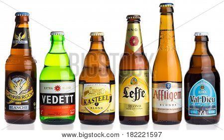 GRONINGEN, NETHERLANDS - APRIL 16, 2017: Collection of Grimbergen, Vedett, KAsteel, Leffe, Affligem, Val-Dieu blond beers isolated on a white background