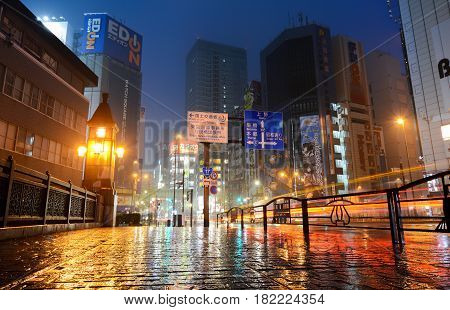 TOKYO, JAPAN - APRIL 8, 2017 - Neon lights of Akihabara, Tokyo's famous electronics shopping district, glittering on a rainy night