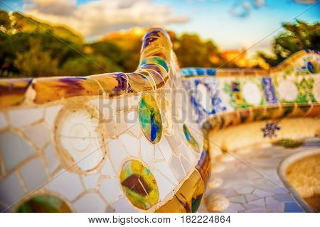 Barcelona, Catalonia, Spain: mosaic in the Park Guell of Antoni Gaudi at sunset
