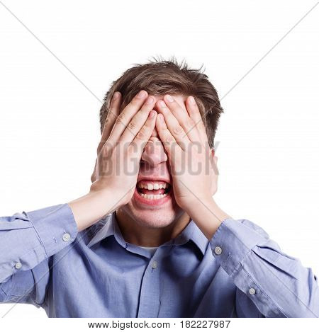 I'm sick of it. Furious man covering face with palms and shouting loudly, expressing aggression or fear, white isolated studio background