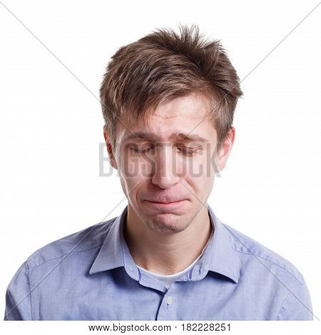 Feeling unhappy. Sad man crying, expressing negative emotion on white isolated studio background