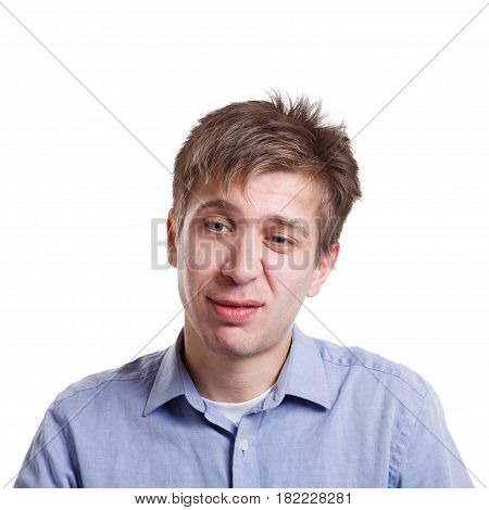 Emotions, facial expressions. Man expressing disgust while standing on white isolated studio background, copy space