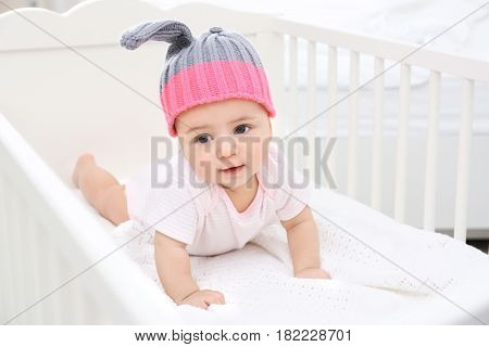 Cute little baby in cradle at home