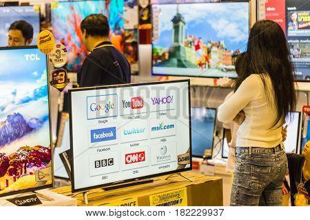 BANGKOKTHAILAND-December 252016: Buyer consider to buy Smart TV in consumer market price drop and popular in Southeast Asia super market